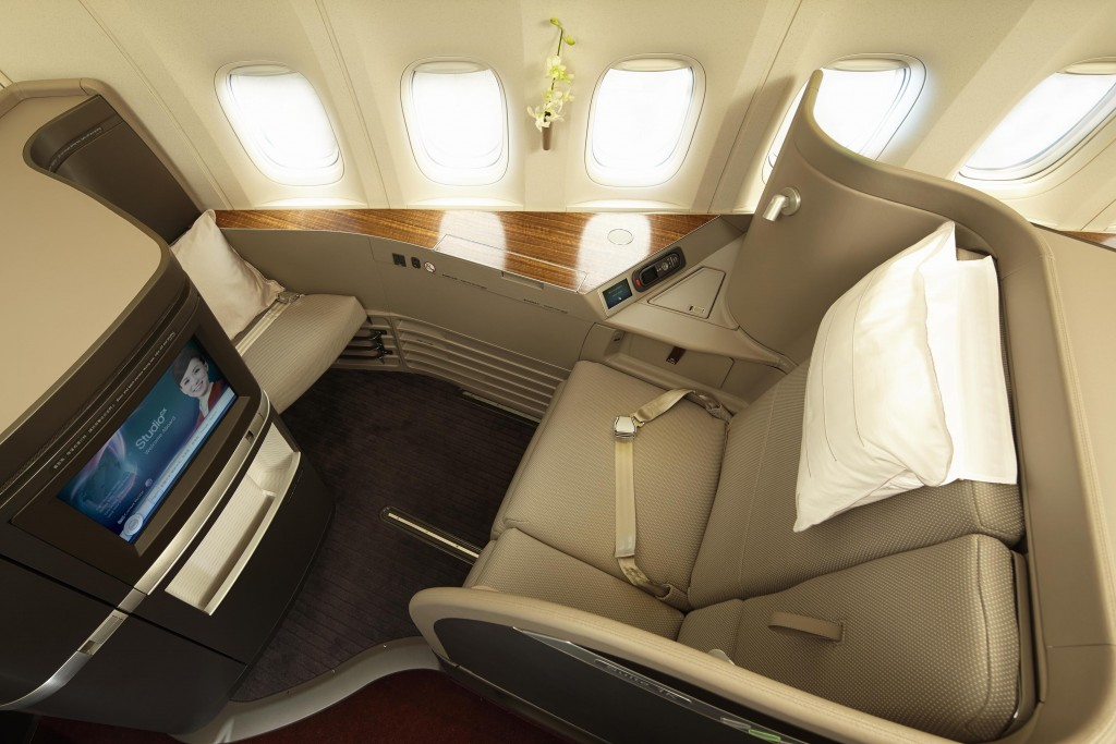 Cathay Pacific First Class: Only six seats and they convert into 6 foot 9 inch by 3 foot beds!